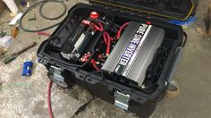 Power on the go - three 27 series 12 volt 115ah batteries in parallel, 3f Cap, 0/1 welding cable, two 150 amp breakers, one battery kill switch, genius 30 amp 3 battery/bank smart charger, 1500 watt pure sine inverter all in a fatmax toolbox on wheels.