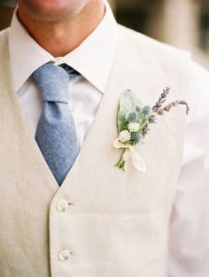 Groom's soft blue necktie paired with cream linen waistcoat for the win!