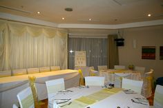 Pearl Yellow Sashes with White Chair Covers