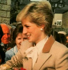 September 26, 1986: Princess Diana in Giggleswick, Yorkshire.   Diana in a beige coat with upper tan lapels and white or cream tie neck blouse.  On her first visit to North Yorkshire since marrying Prince Charles, she toured Greenfoot residential home and care centre at Settle and Castleberg Hospital at Giggleswick. The royal visitor charmed staff, residents and patients alike.