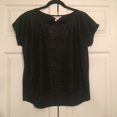 BCBG black xsmall night out top Semi-crop in the front, longer in the back. Flowly black textured and a semi shimmer/glisten when light hits it. Nice with jeans or can be dressed up. Light, suave material BCBGeneration Tops Blouses