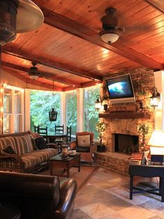 The Perfect Porch - With comfy seating, a working fireplace and a flat-screen TV mounted above, this is sure to be the most popular place in the house.