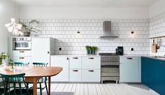 Compact huis met blauwe keuken als eyecatcher