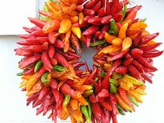 Bright and happy chili wreath--maybe for small centerpieces or for hanging around the venue?