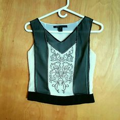 Marc Jacobs 100% silk sleeveless blouse This Marc Jacobs black and cream  tank top is made out of 100% silk and has elegant embroidery on both front and back. Side zipper. Size 4. Marc Jacobs Tops Blouses