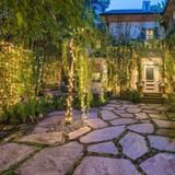 A beautiful patio courtyard welcomes visitors to this 5,500-square-foot, traditional-style Beverly Hills, Calif., house. The former home of celebrity fashion designer and singer Jessica Simpson, the courtyard also includes a koi pond to add to the tranquil feeling of the private surroundings. | HGTV FrontDoor