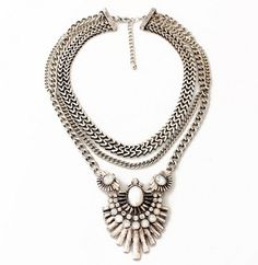 "Amp up the glamour with the Ashby Necklace. This large silver statement necklace is a high impact accessory that will have all heads turning in your direction. Length: 21"" + 2.5"" Pendant Size: 2.75"" l"
