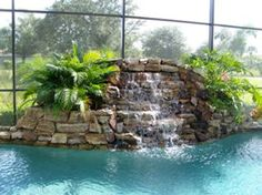 Pool Waterfall #3 | Uni-Scape Waterfalls, Natural Stone Work, Ponds, Swimming Pool and Spa Renovation, Flagstone Patios and Outdoor Kitchens.
