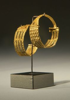 ETRUSCAN GOLD FILIGREE EARRINGS  Openwork ribbons filled with wire bands, bosses, scrolls. Probably from Vetulonia  Ca. 1st 1/4 of the 7th cent. BC
