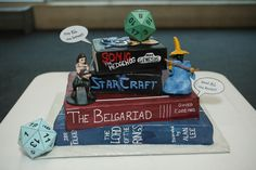 Our Wedding Cake says all: DND, RPG's, Fantasy books, Fave games and a meme. Us in a nutshell. and Delicious! Crafted by Peace, Love and Cake in Safety Harbor, Fl. All buttercream no fondant. Also I made the toppers. Photo by Studio 81 Photography in Tampa.