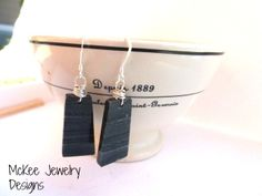 Black and grey Gemstone with sterling silver wire wrapping earrings. McKee Jewelry Designs
