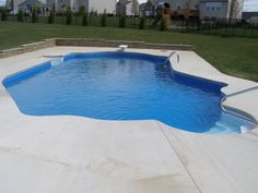 """Lazy """"L"""" with Cantilever deck, love seat and retaining wall"""