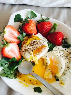 Farm Fresh organic poached eggs with strawberries. Great low-carb dish good any time!