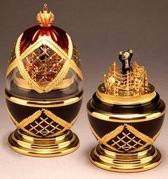 Symphony Egg :: Theo Fabergé..The SYMPHONY EGG is free blown in lead crystal. Surmounting the creation is the Russian Imperial Crown set with a cabochon ruby. Lattice work decorated with 24 carat gold is engraved between the hand-enamelled ruby panels of the top. The famous swags synonymous with the Fabergé family's work are engraved and gilded on the rich black enamel of the base.