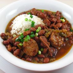 Slow Cooker Red Beans and Rice. Comfort Food! I would substitute the meat from a smoked turkey leg for the ham hock but this looks very good.