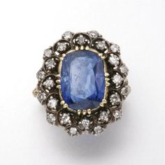 18K GOLD, SILVER, SAPPHIRE AND DIAMOND RING, BUCCELLATI 1 cushion-shaped sapphire and 24 diamonds approx 4.25 & 0.60 ct,