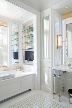 G.P. Schafer Architect, PLLCMirror placed in upper door of floor to ceiling cabinet adjacent to the vanity. G.P. Schafer Architect, PLLC