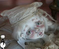 Here is my work that will be presented during my next exhibition in Minsk, The Panna Doll'ya in March 25-27th: www.facebook.com/groups/pannadollia/?fref=ts My handmade dolls in paper clay and fabric, hair in mohair or Alpaca, outfit in antique French laces and leather shoes And my handmade plushies, a serie of bunnies in different sizes In the background an adorable wood theater made by my friend Eponyme Einnie
