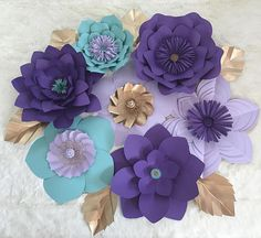 *********DUE TO THE OVERFLOW OF ORDERS, TURN AROUND CAN TAKE ANYWHERE BETWEEN 6-8 WEEKS. PLEASE MESSAGE BEFORE PLACING YOUR ORDER IF YOU NEED THEM BY A CERTAIN DATE SO I CAN CONFIRM DELIVERY. BOOKED FOR THE MONTH OF APRIL, MAY, AND JUNE**** This set is perfect for your party decor, wedding decor, or living decor. This 7 piece set includes flowers ranging from 18 to 10. If you are near the Chicagoland area, please send me a message before purchasing so we can avoid shipping costs. *****LE...