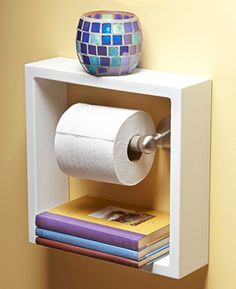Pretty nifty idea with a bought frame and some paint. Maybe it could be helpful in your bathroom..or mine!
