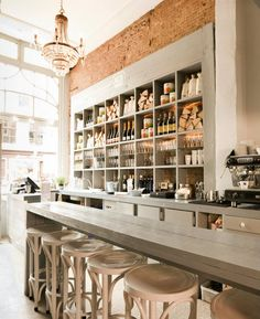 Bakery Café / Coffee Shop Design.  Love the exposed brick walls and grey woodwork