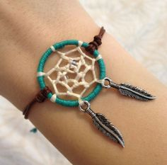 Dream catcher bracelet with feather charms. $15.00, via Etsy.