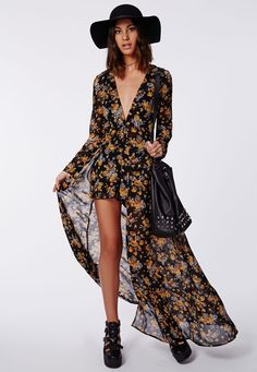 We're major fans of this floral playsuit which combines your favourite styles - a plunge romper with a floor length chiffon overlay, bringing you your ultimate must-have of the season. A fresh alternate to a dress, pair with a black fedora ...
