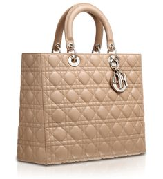 8cd1c3266590 I know everyone in the world has got one but I love this bag by Dior