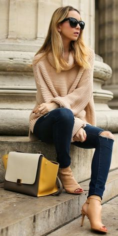 Camel Loose Cowl Neck Sweater with Destroyed Skinny Jeans and Handbag or Booties.