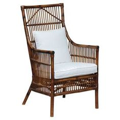 Rattan high-back arm chair with a cotton cushion and pillow.   Product: ChairConstruction Material: Rattan  and cottonColor: BrownFeatures:  Perfect curvesCushion and pillow included Dimensions: 40 H x 26 W x 30 DCleaning and Care: Remove dust with a soft, lint free cloth