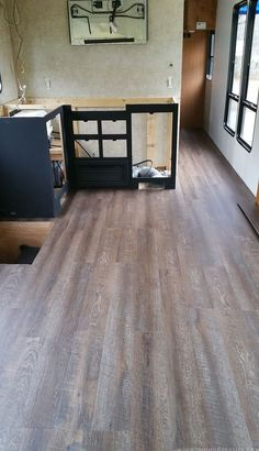 Are you looking to replace your RV flooring? Check out how we did just that in our motorhome to give it a more rustic modern vibe.   MountainModernLife.com Camper Flooring, Diy Rv, Dyi, Rv Interior, Interior Design, Interior Ideas, Vinyl Plank Flooring, Wooden Flooring, Tile Flooring