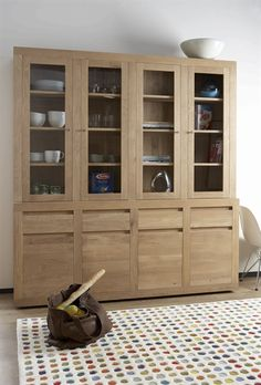 Flat Door Dresser.  Ethnicraft has designed a cupboard that is both beautiful in colour, grain and texture, and functional. The piece is a timeless classic, and goes well with many styles. Available in Teak, Oak and Walnut and offered in various sizes.