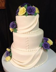 Wedding Anniversary Cake with Violet (look kinda blue but were deep violet) and Yellow Fondant Roses!