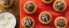 These frosted cookie cups are hiding a delicious secret—Snickers™ fun-size candy bars are baked into the center of each one!