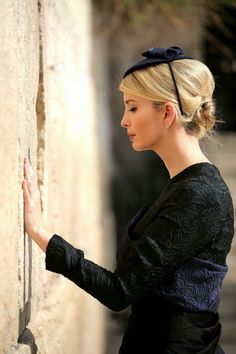 "Touching photo of such a beautiful woman at a most ""Holy"" place ""The Western Wall""❤️"