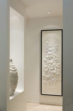 simple white artworks for a stunning entrance hall - Cecconi Simone: