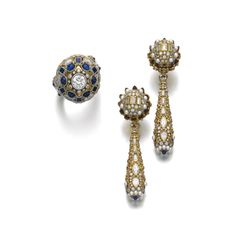 Gem set and diamond demi-parure, Elmar Seidler, first half of the 20th centuryComprising: a pair of earrings and a ring decorated on the front and back with intricate metal work, millegrain-set with variously cut sapphires and diamonds, the earrings...