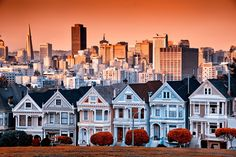 Victorian homes on Steiner Street and the San Francisco skyline from Alamo Square Park