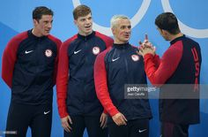 Conor Dwyer, Francis Haas, Ryan Lochte, Michael Phelps of Team USA celebrate winning the gold medal during the medal ceremony of the men's 200m freestyle relay on day 4 of the Rio 2016 Olympic Games at Olympic Aquatics Stadium on August 9, 2016 in Rio de Janeiro, Brazil.