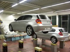 Exact copies in every detail (down to the working lights) of 2 radio controlled flying BMW 1 cars.