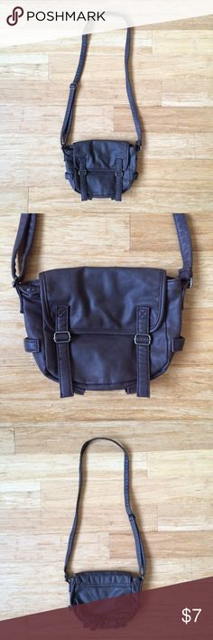 "Vegan Leather Bag Dark brown, vegan leather crossbody bag from American Eagle Outfitters. Gently used. Magnetic button closure. Adjustable strap. Inner, zippered pocket. 8"" width x 6.25"" height x 3"" depth. No holes, no stains! American Eagle Outfitters Bags Crossbody Bags"