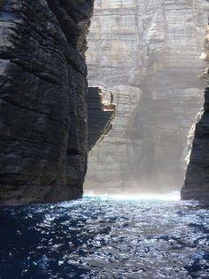 Rock climbing in Calala Bay, New South Wales, Australia