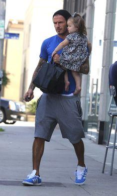 Mr David Beckham wearing Adidas Originals by DB sweat shorts and matching blue Adidas Gazelle sneakers.