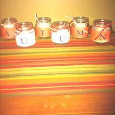 Repurposed baby food jars. ....like the thought of tealight jars but with different letters