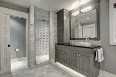 Amazing grey bathroom featuring LED lighting under the vanity design by Carly Visser Design, custom crafted by Woodways. #bathroom #design #luxury #custom