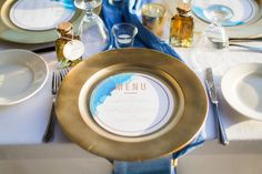 Elegant tropical island destination wedding reception - gold charger plates and round menu cards with blue watercolor design  {Lindsay Vann Photography}