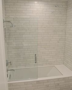 Kids tub shower surround combo. All out of Cararra marble subway tile and a quartz tub deck. #marble #bathroom #kidsbathroom #tile #carrara #white #home #whitedecor #houzz #modern #millhavenhomes #quartz #homesweethome #design #BrightWhiteWednesday #utahbuilder