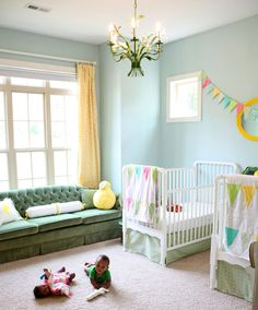 Couch in the nursery or kids room.. Awesome idea!! Cute wall bunting & quilts! Love the pale yellow curtains!
