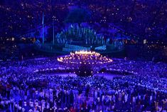 Coming together ... copper petals lit by young British athletes rises to form the Olympic cauldron