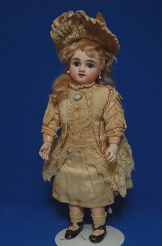 Darling antique french bebe by Steiner firm in all original costuming